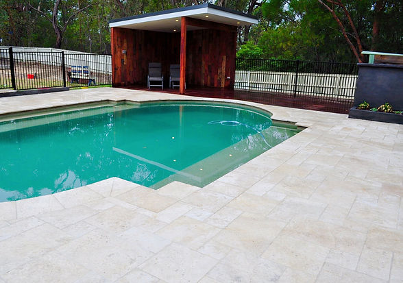 Travertine paver pool surround