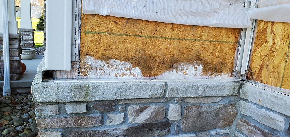 Water damaged framing behind incorrectly installed masonry stone veneer