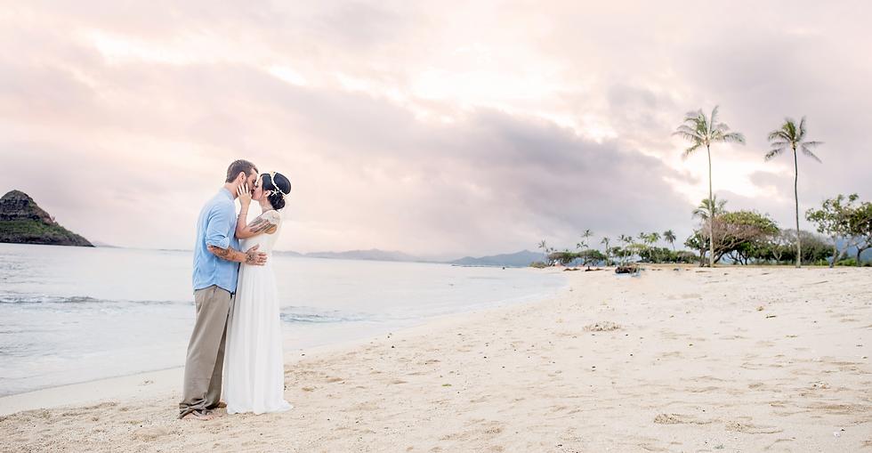 couple kissing on beach in hawaii