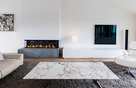 belgian hard ston glass encased fireplace