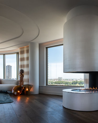 elegant oval fireplace with a marble finishing