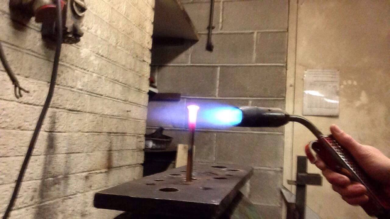 Heating Bronze Bolts for Forging