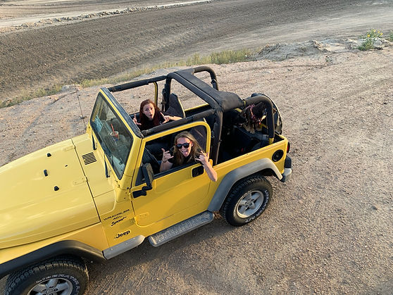 Yellow jeep yj wrangler sport girls 4-wheeling ram off-road park off-roading top down