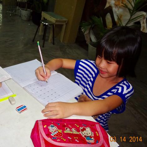 Mai doing her homework @ Lai Thieu, HCMC, Vietnam