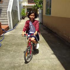 Mai & her bike after school,  Lai Thieu, HCMC, Vietnam