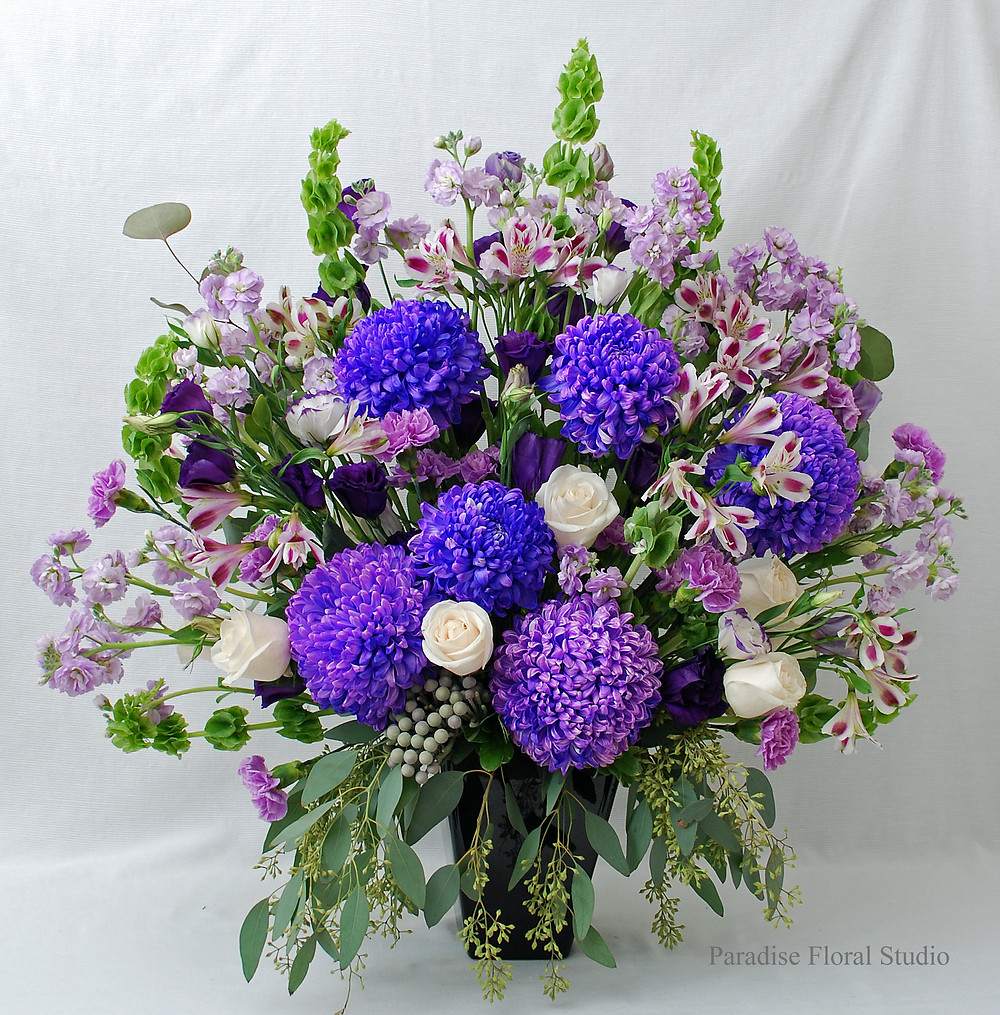 Large arrangement, altar, reception, commercial mum, bells of ireland, lavender, stock, alstroemaria, vendela, roses, carnations, silver brunia, paradise floral studio, wedding