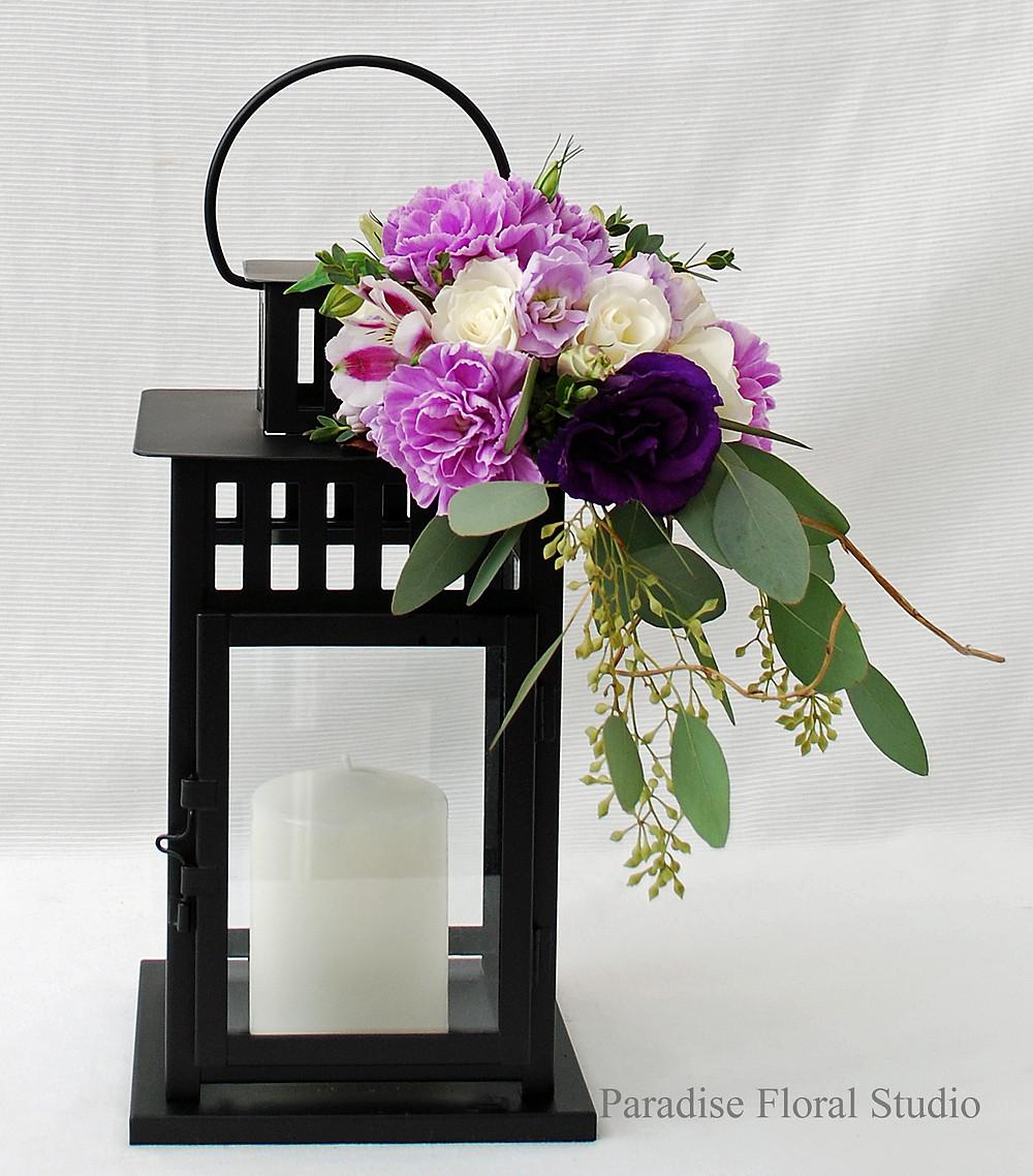 Lantern with fresh flowers, wedding, carnation, purple, lisisanthus, roses, eucalyptus, showers, paradise floral studio