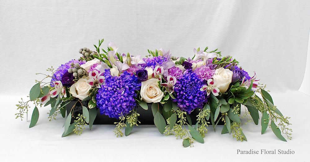 Long table flower arrangement, commercial mums, vendela, roses, freesia, alstroemeria, lisianthus, carnations, purple, eucalyptus, brunia berries, paradise floral studio
