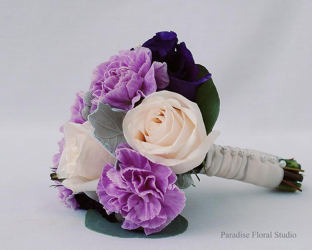 Flower girl bouquet, vendela, roses, carnations, purple, lavender, brunia berries, lisianthus, dusty miller, silver dollar eucalyptus, paradise floral studio