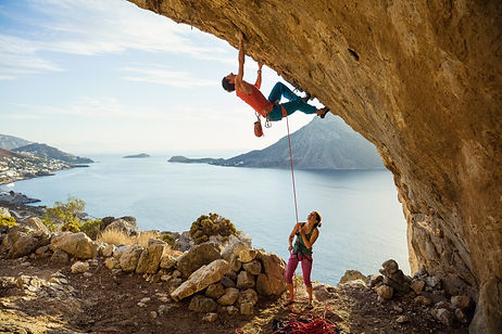 Young man starts climbing challenging ro