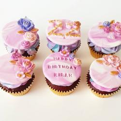 fondant topped birthday cupcakes