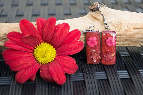 Ruby red resin with forget me nots and leaves in dangly earrings