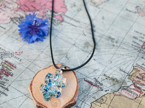 Lightweight funky blue sparkle and beaded jigsaw shaped resin pendant