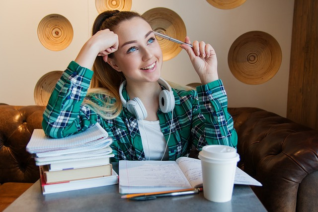 Teenage girl student with notebooks