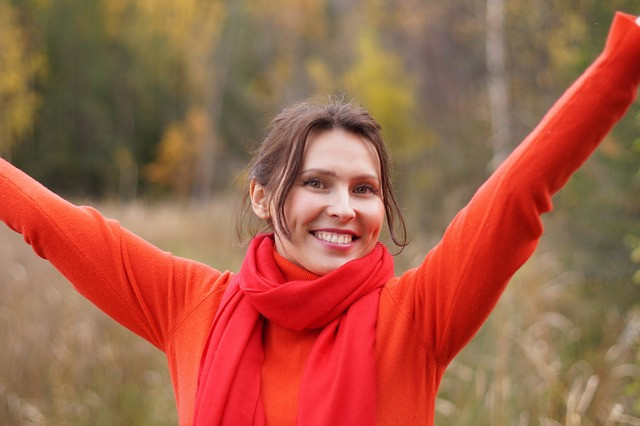 Smiling lady feeling positive emotions.