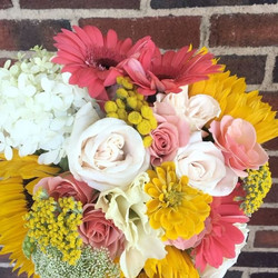 Congrats to our bride and groom on their wedding day! The bride requested sunflowers and gerbers wit