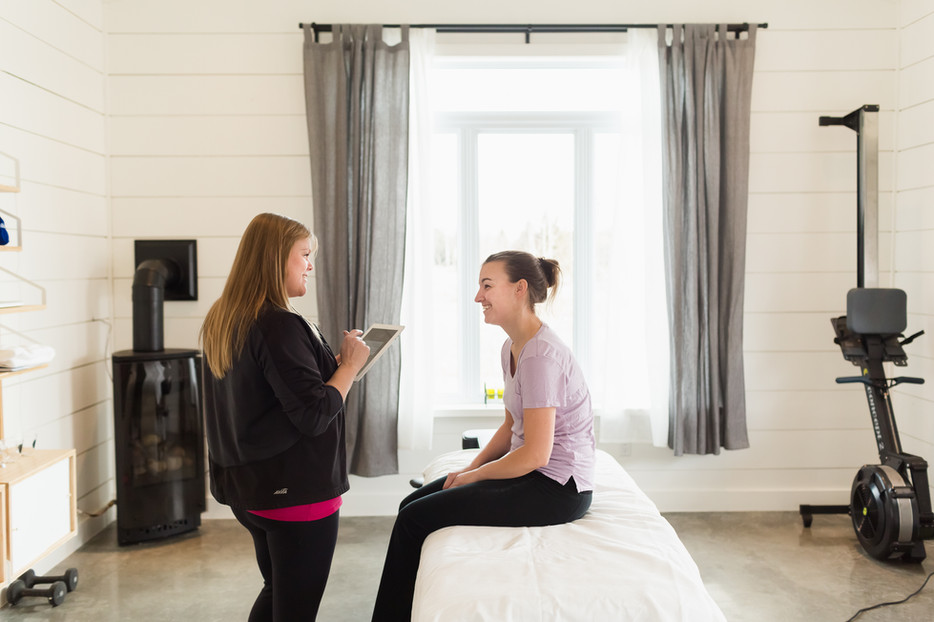 Massage Therapist with a client