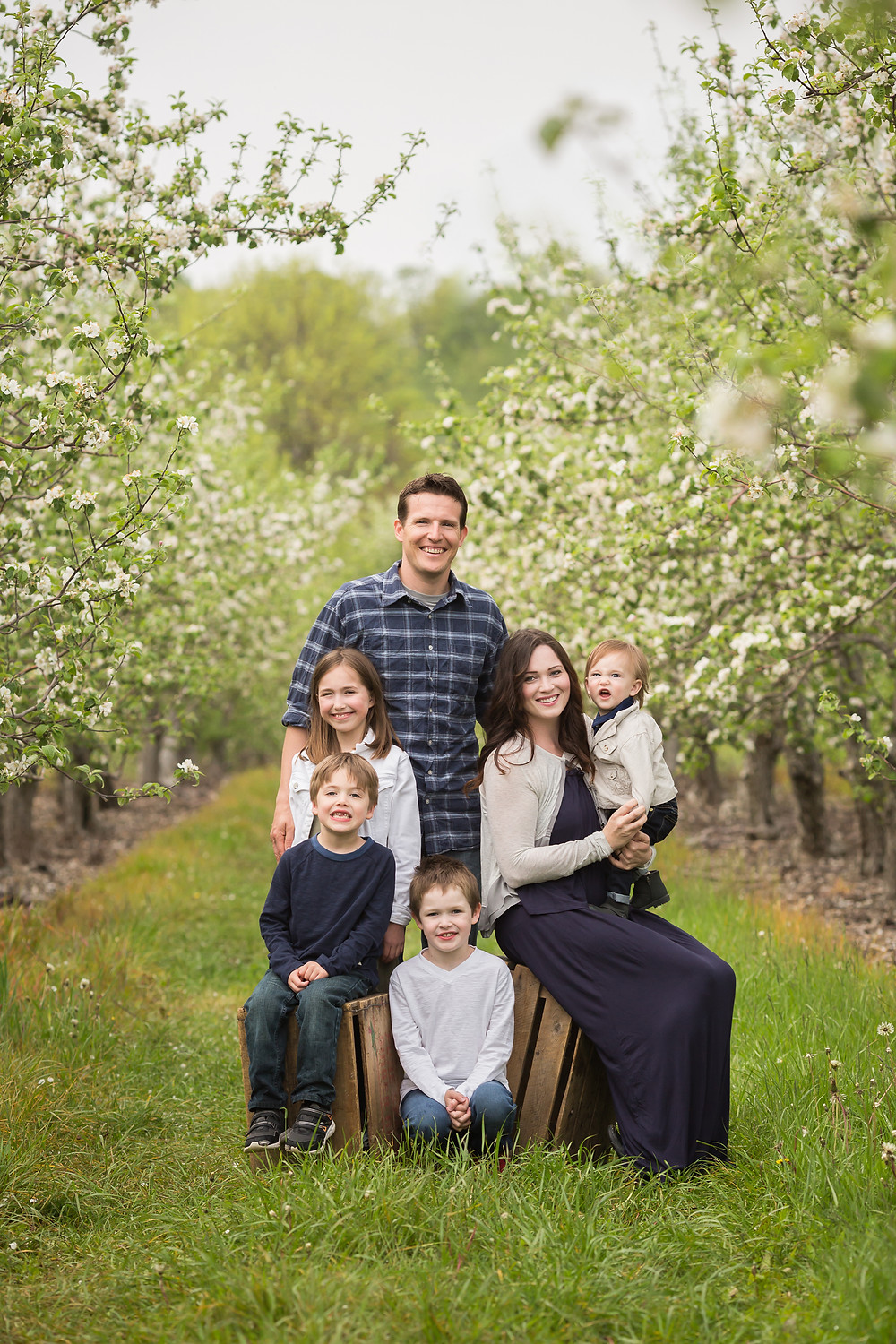 family portrait in the apple blossoms