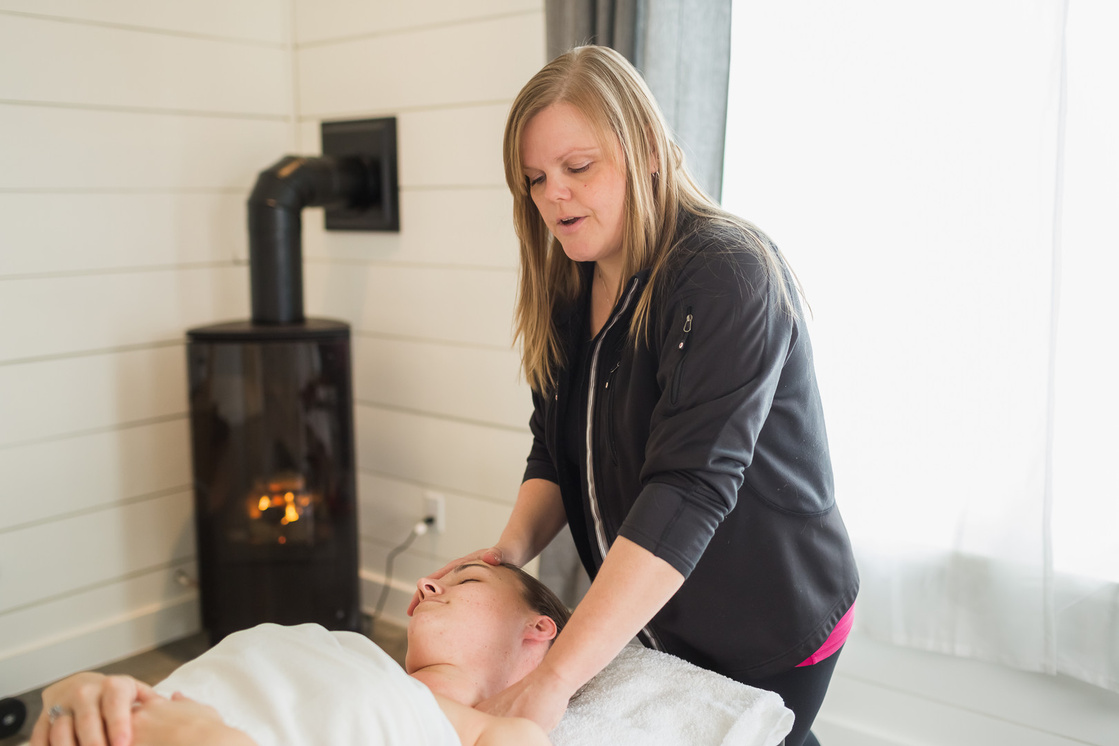 Behind the Scenes shot with a client for a massage therapist's personal brand photography session