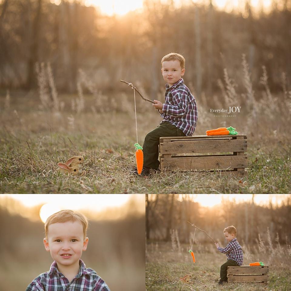 little boy fishing for bunnies in field