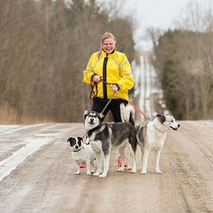 Woman running with dogs