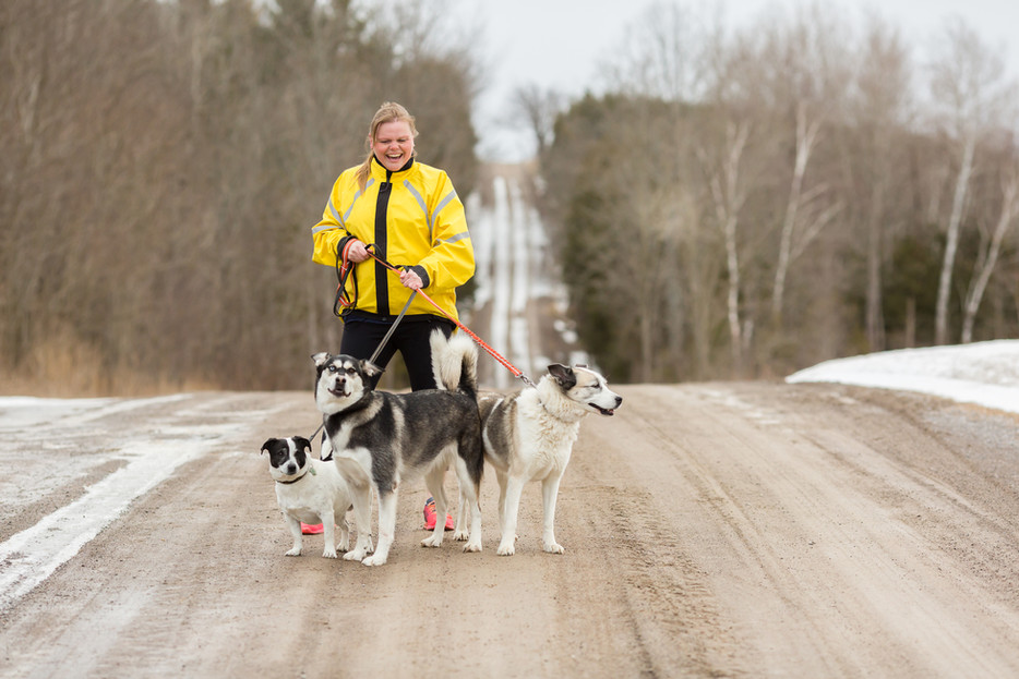 Massage Therapist running with dogs for personal brand photography