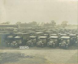 Kempton Park Lorries and grandstand.jpg