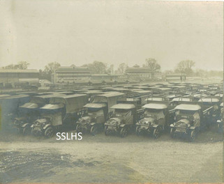 Kempton Park Lorries and grandstand.jpg