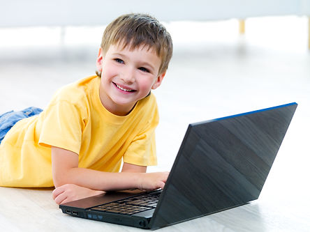 portait-happy-smiling-young-boy-with-lap