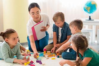 woman-teaching-kids-new-game-kindergarte