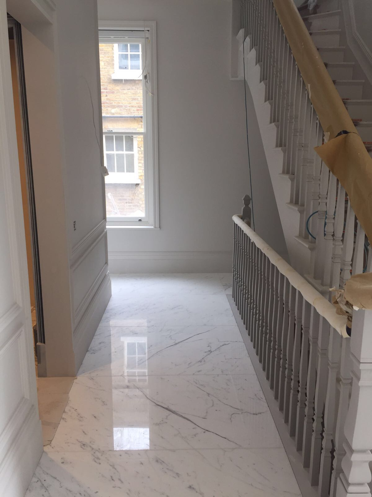Statuario mable bookmatch flooring in London  (1)