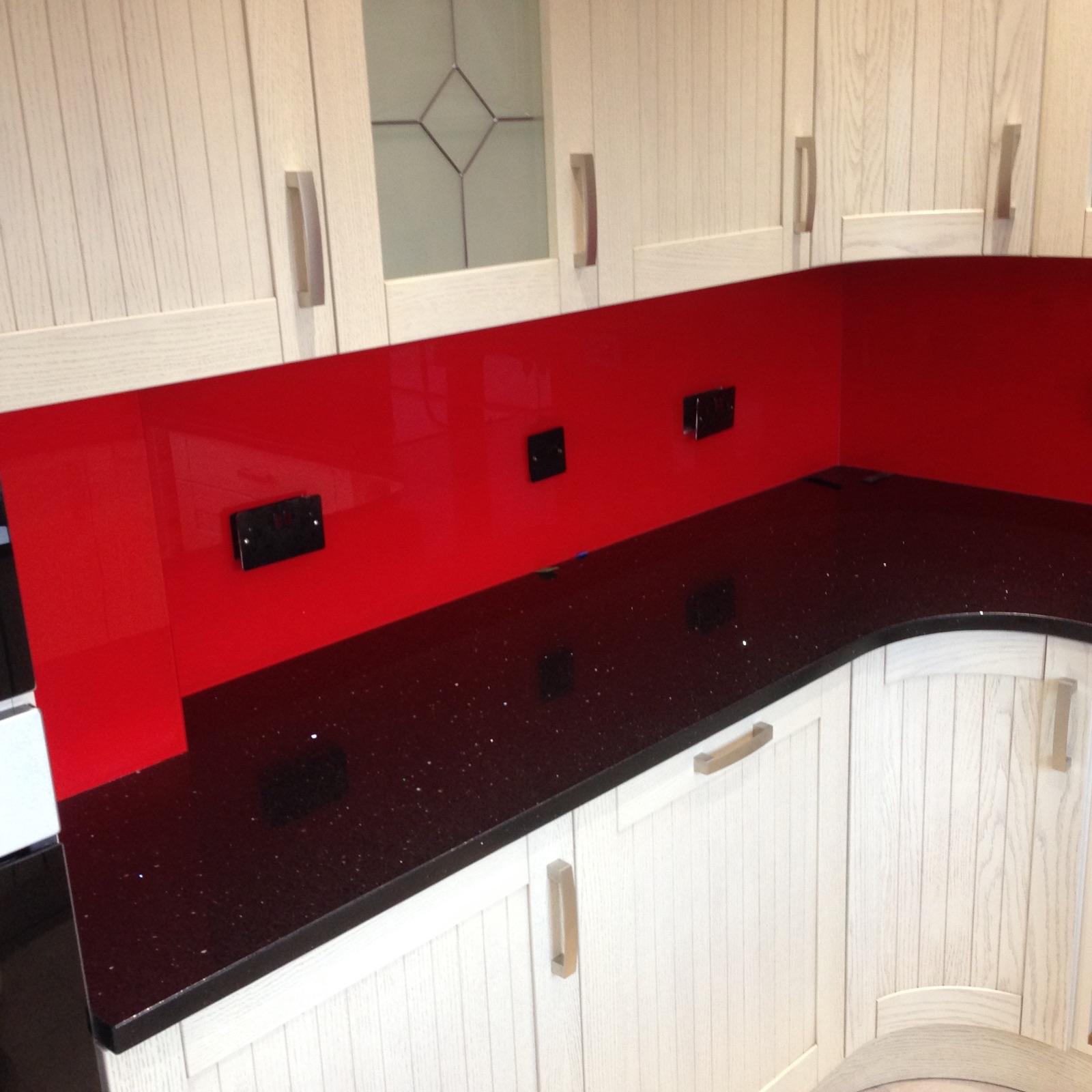Black Graite woktop and red glass splashback in London (3)