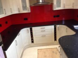 Black Graite woktop and red glass splashback in London (2)