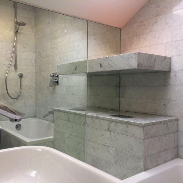 Carrara marble bathroom walls