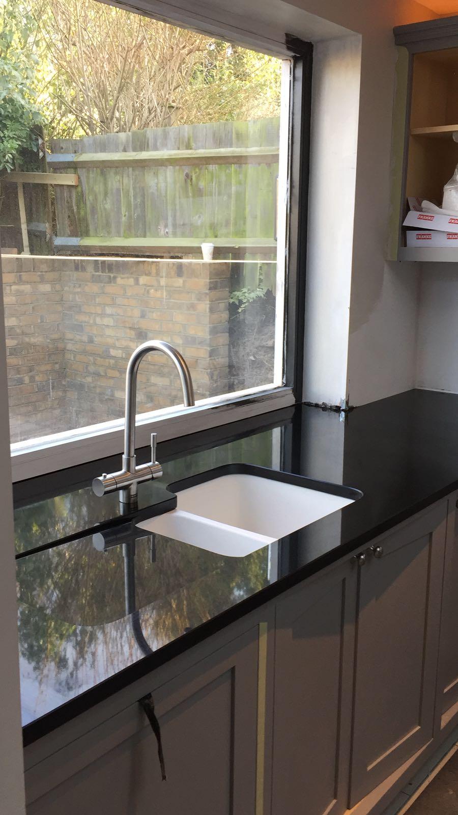 kitchen surfaces combined - Black granite plus Staturio island (3)