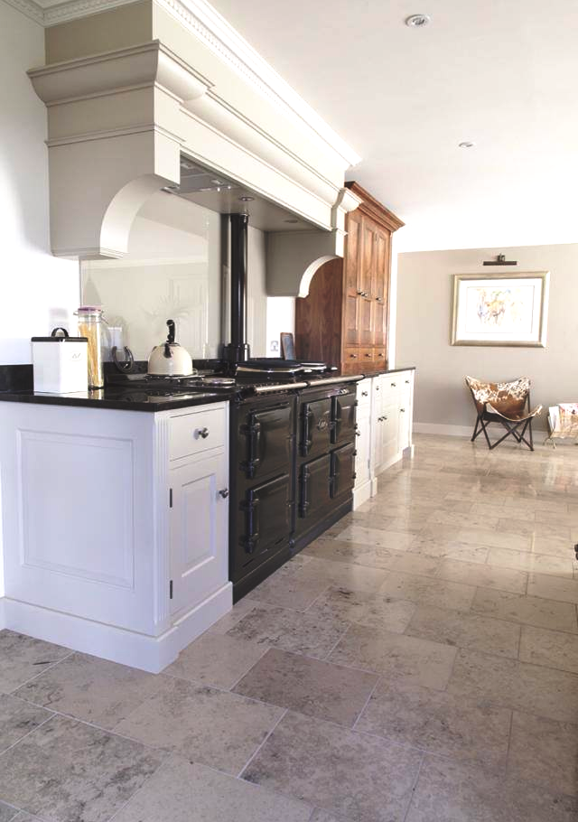 Traditional kitchen stone flooring and granite worktop