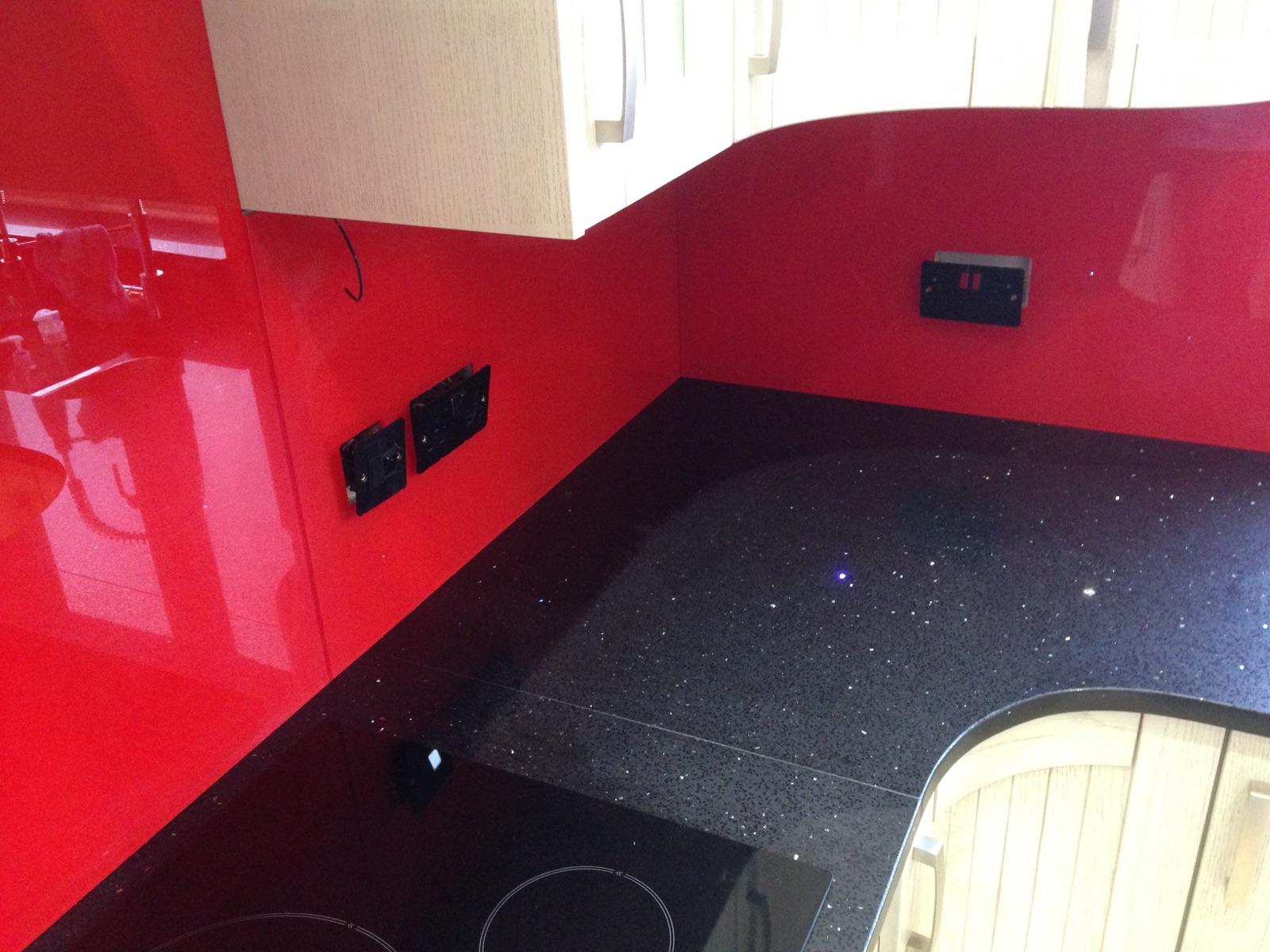 Black Graite woktop and red glass splashback in London (5)