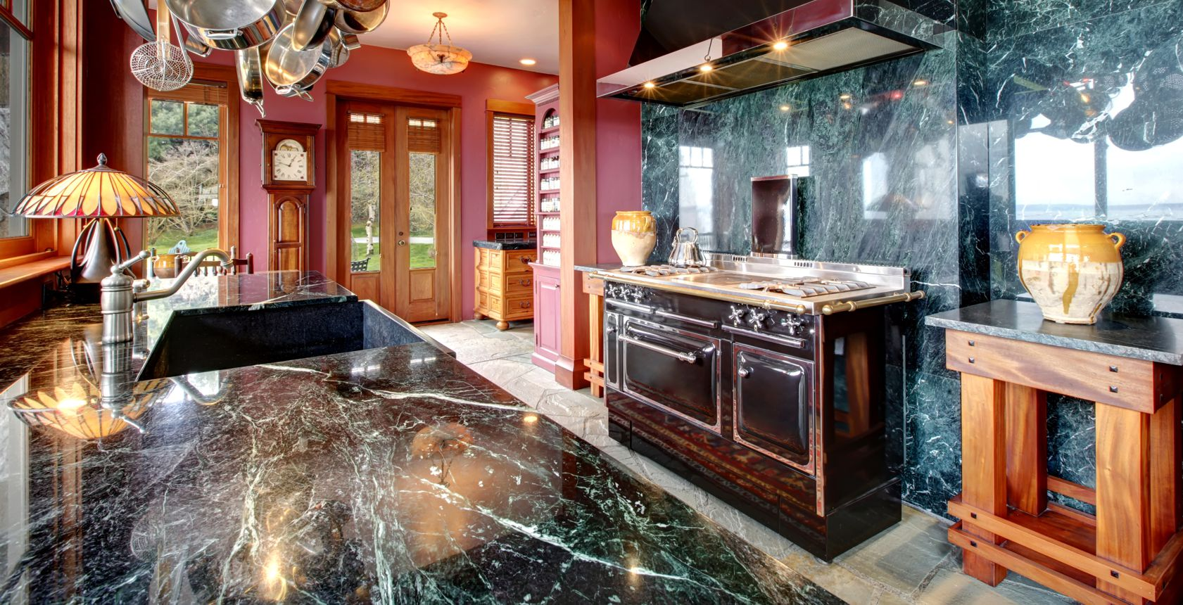 green marble kitchen worktop and walls