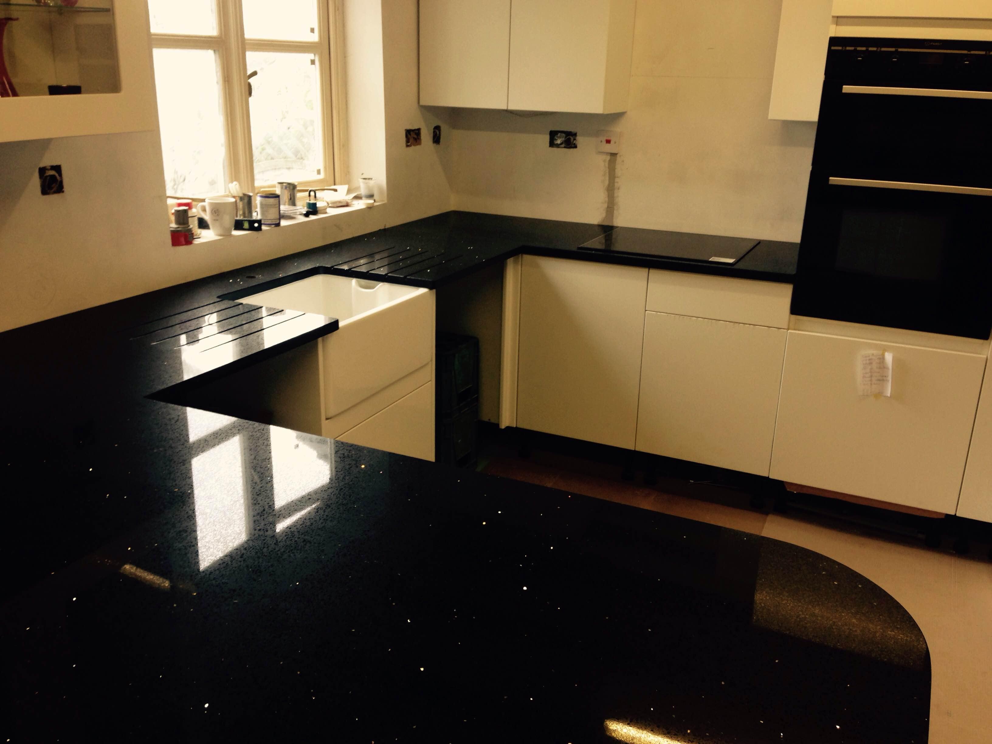 black quartz worktop with island in London (1)