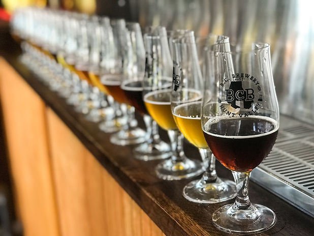 row of BCB glasses with different beer filled halfway in each