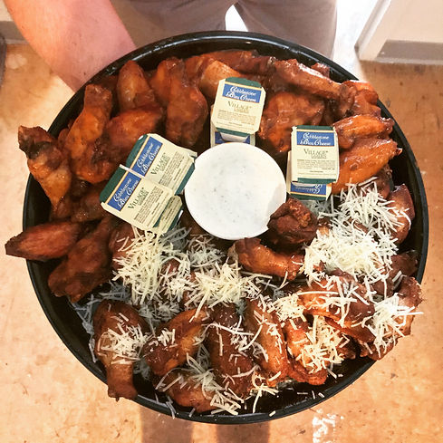 a platter of 50 wings with blue cheese and ranch