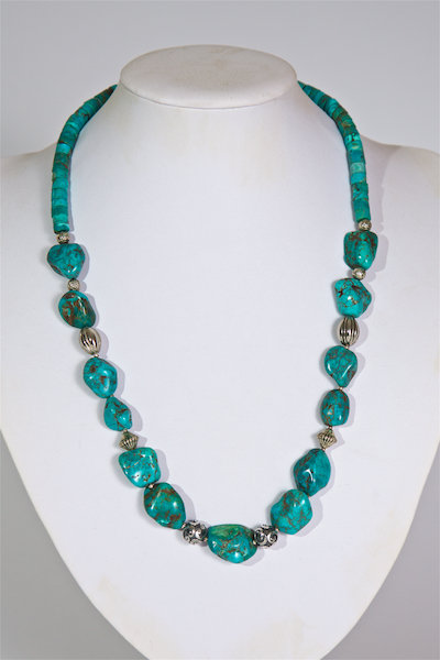 675  Turquoise, silver and howlite