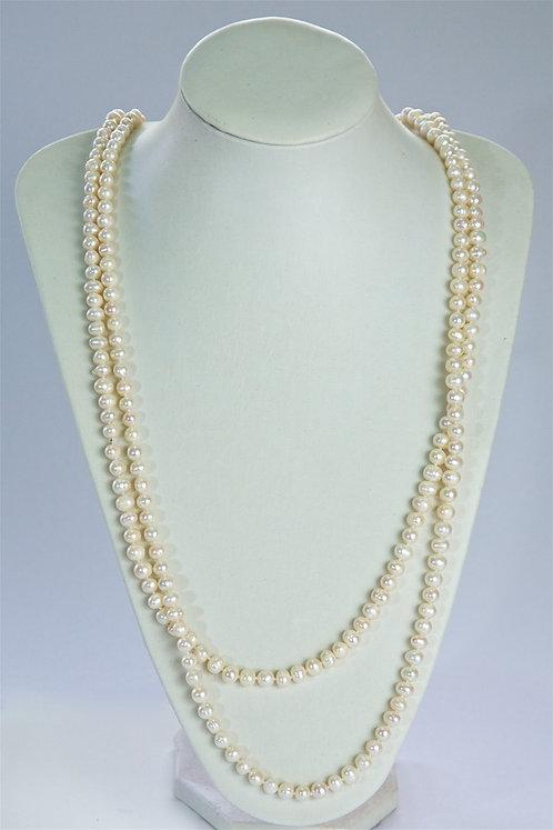 656  Long Cream Pearls