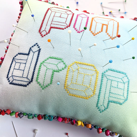 Let Lucy Brennan hone your sewing skills with these two Modern Cross-Stitch Pin Cushions!
