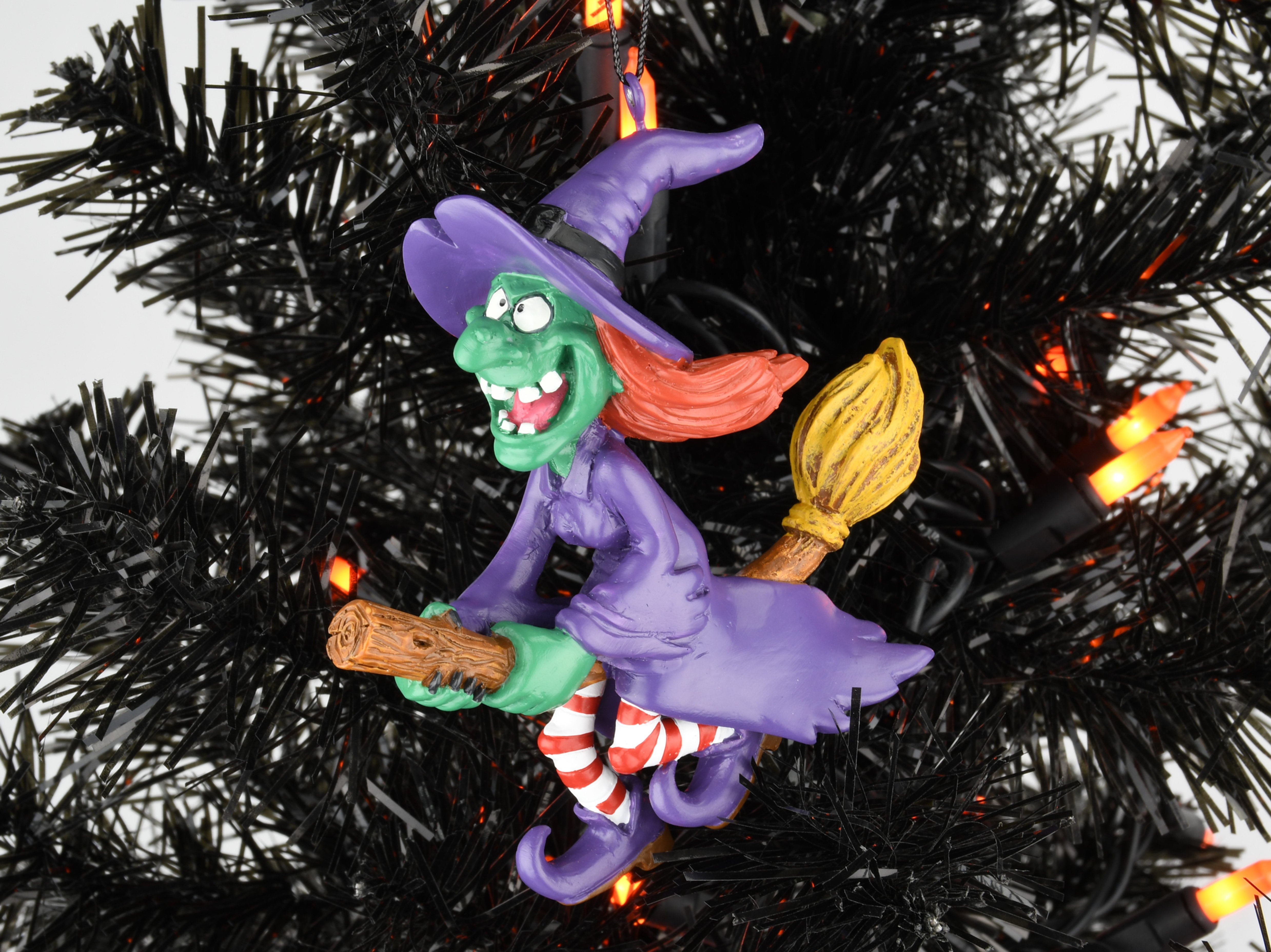 Witch Flying Into Tree Decoration  from static.wixstatic.com