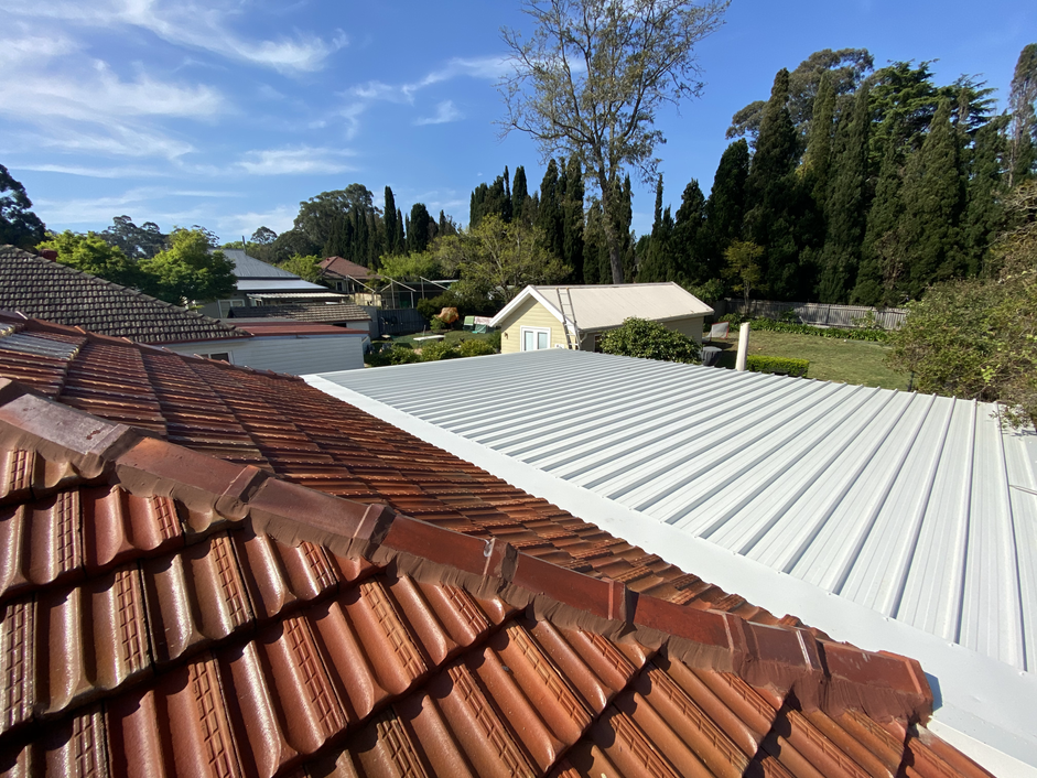 FLAT METAL ROOF REPLACEMENT AND INSULATION