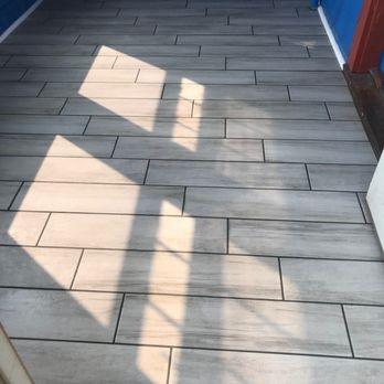 Remodel of front entrance: tile installation