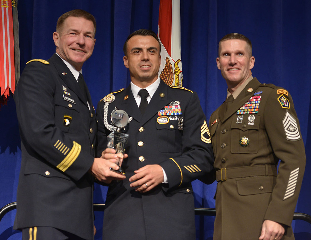SFC Sean Acosta accepts the NCO of the Year award.
