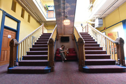 Grand double staircase at Gaslamp Hostel San Diego