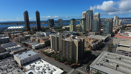 A view of downtown San Diego, the convention center and shoreline from high above 5th Avenue.